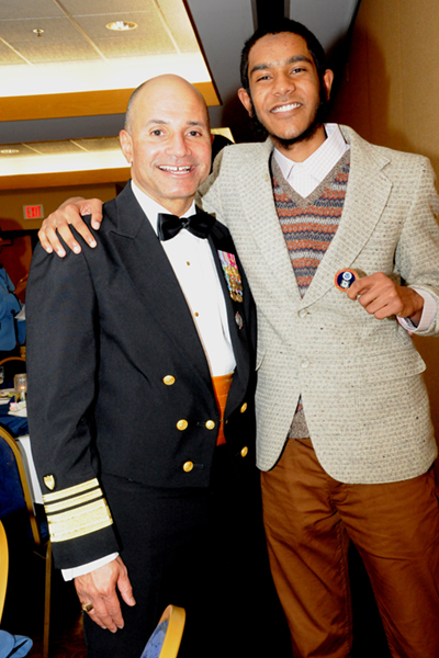 Alan Hai receives special coin from Vice Admiral Manson Brown, USCG